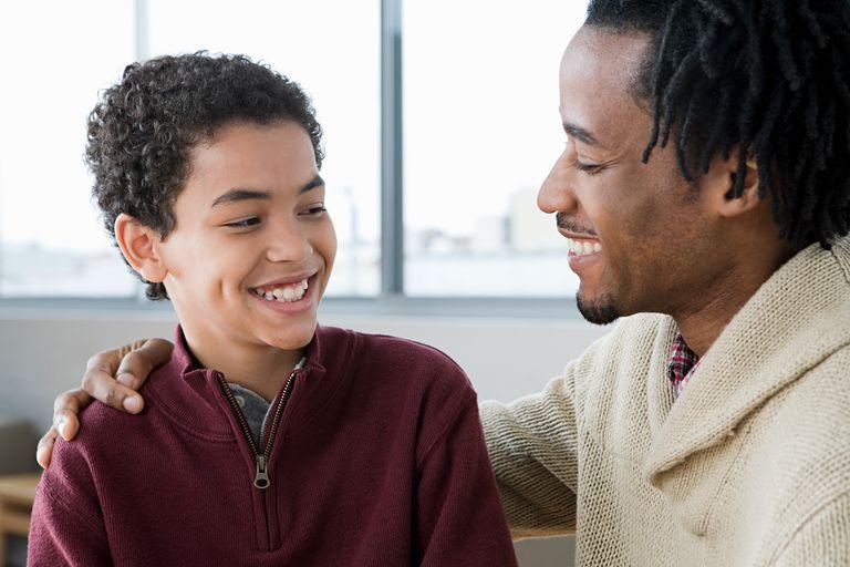 Man mentoring boy