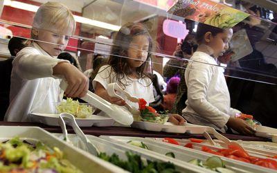 kids filling plates at salad bar
