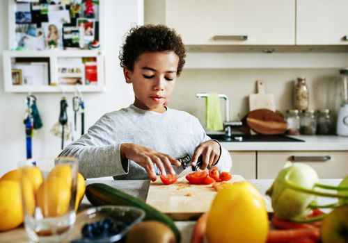 Child making healthy food