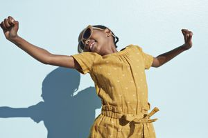 Portrait of jumping cool girl with sunglasses
