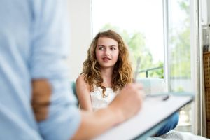 Young girl talking to therapist
