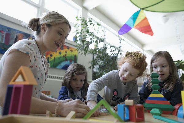 Teacher playing with preschool students
