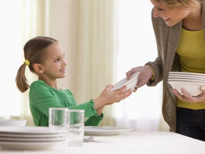 girl setting the table