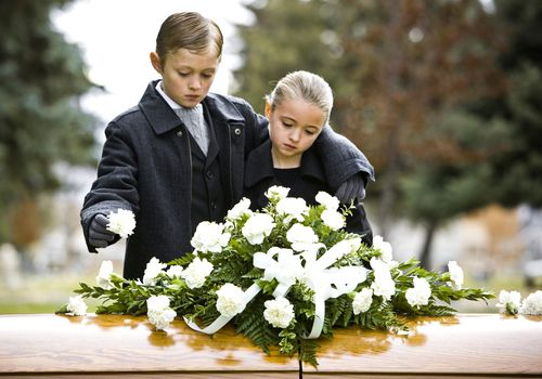 Children in front of casket