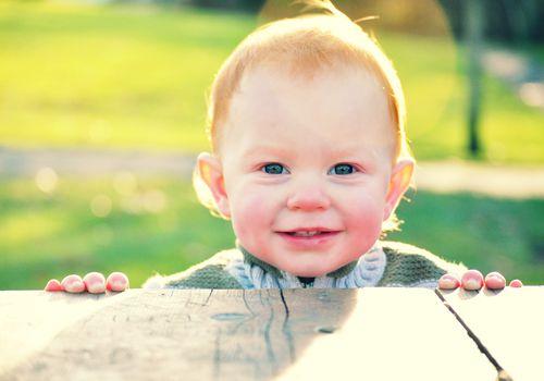 Smiling boy red hair