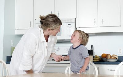 Mother trying to calm crying child