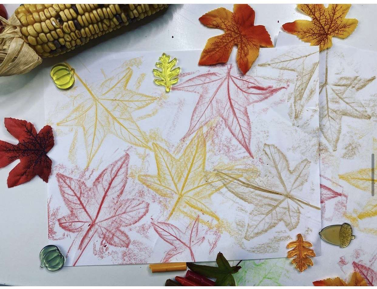 Leaf rubbings in a variety of colors on paper