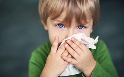 boy wiping nose