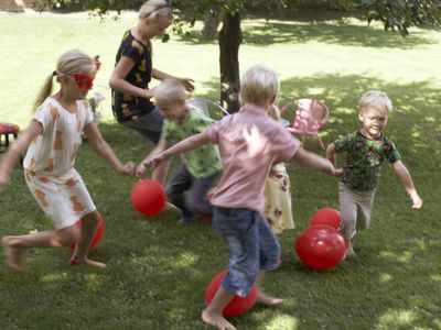 Kids playing a game with balloons