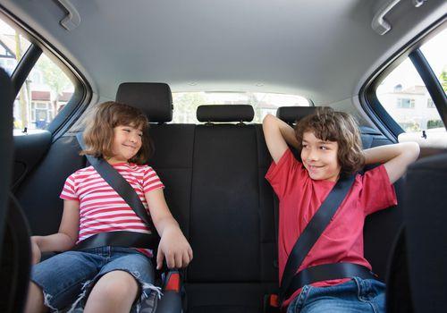 Children sat in a car