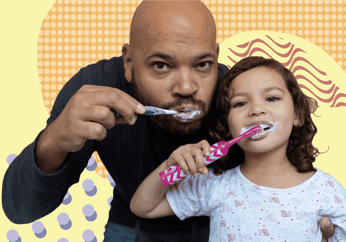 Father and daughter brushing their teeth
