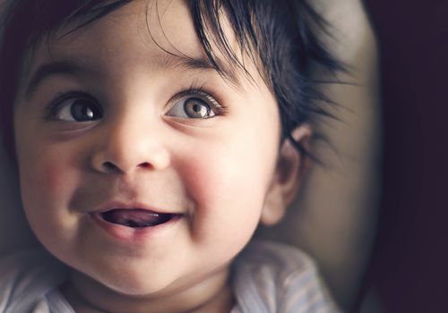 Indian baby smiling