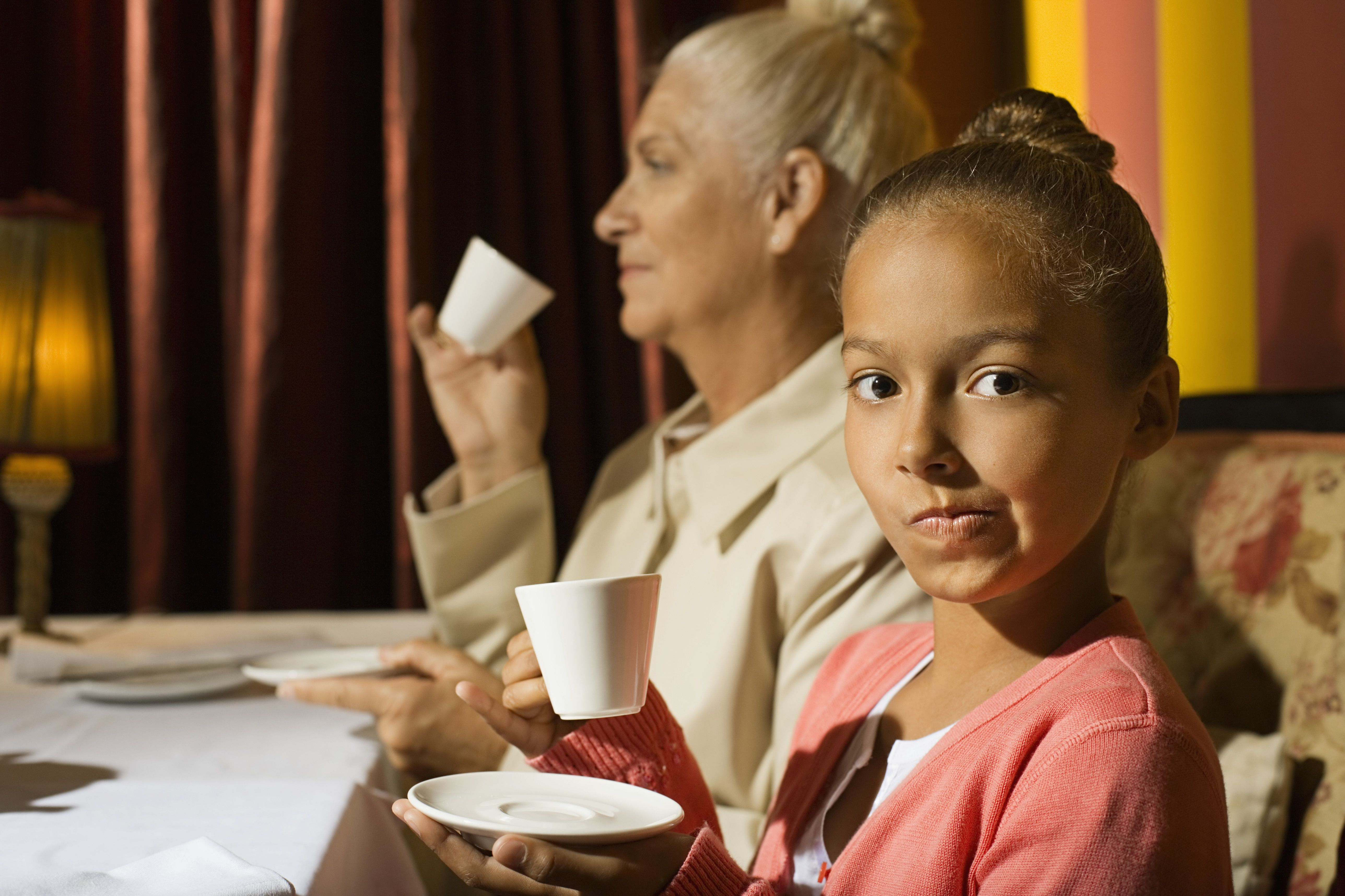 Girl Drinking Coffee with Grandmother