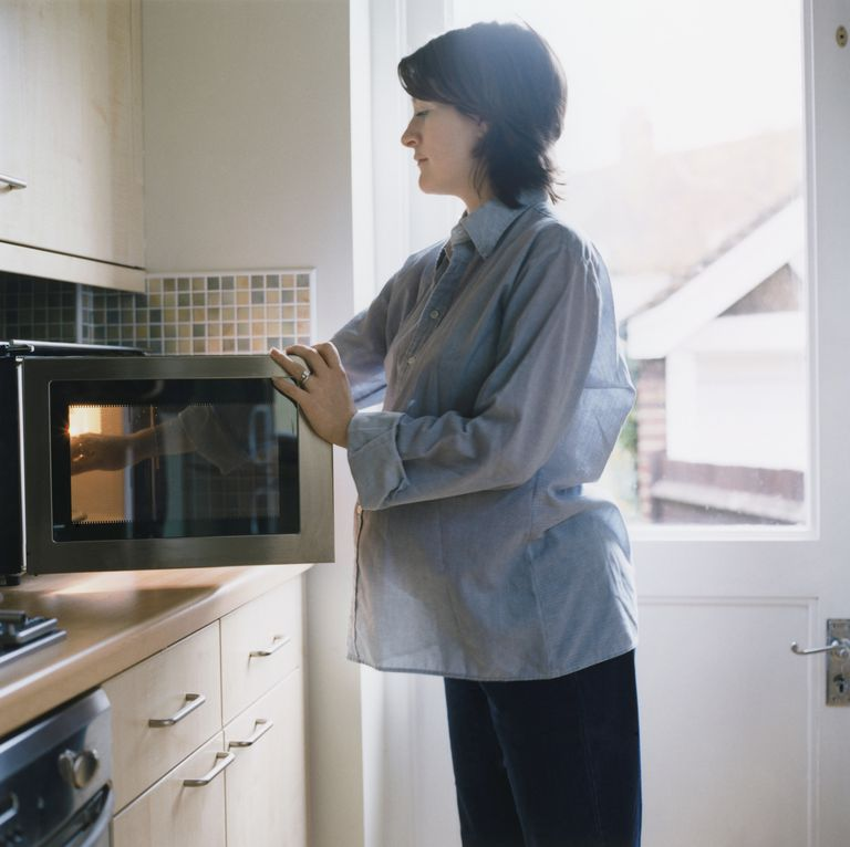 Pregnant woman using microwave