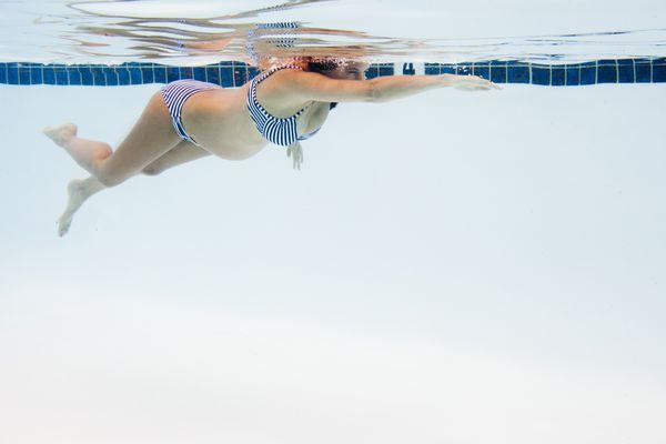 Pregnant woman swimming