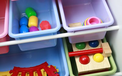 Colorful toy storage bin with toys inside