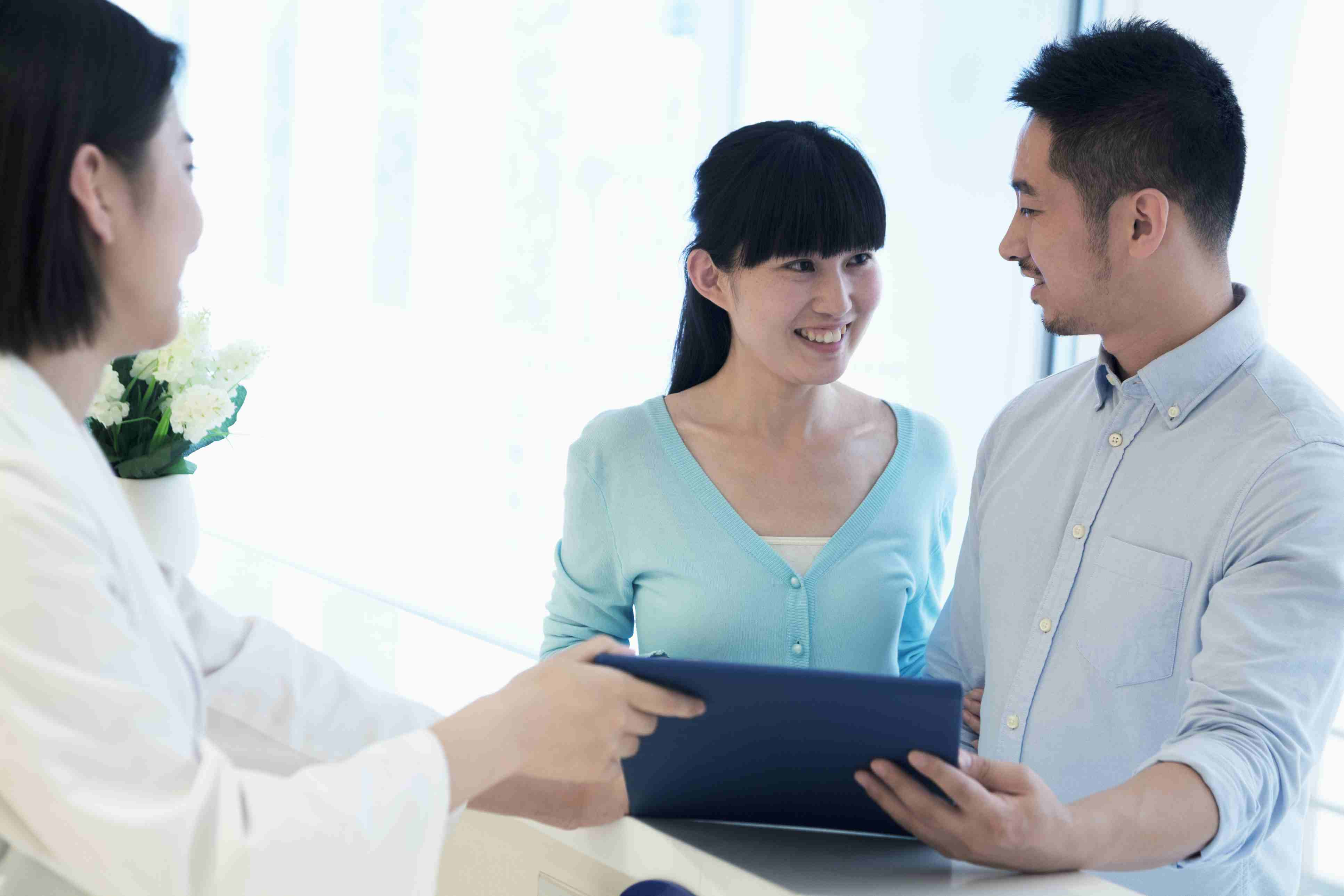 Couple speaking to a doctor about fertility treatments