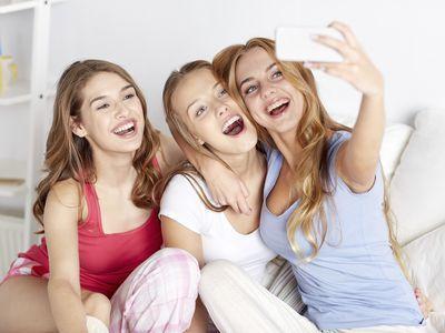 teen girls taking a selfie