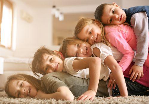 siblings in a pile