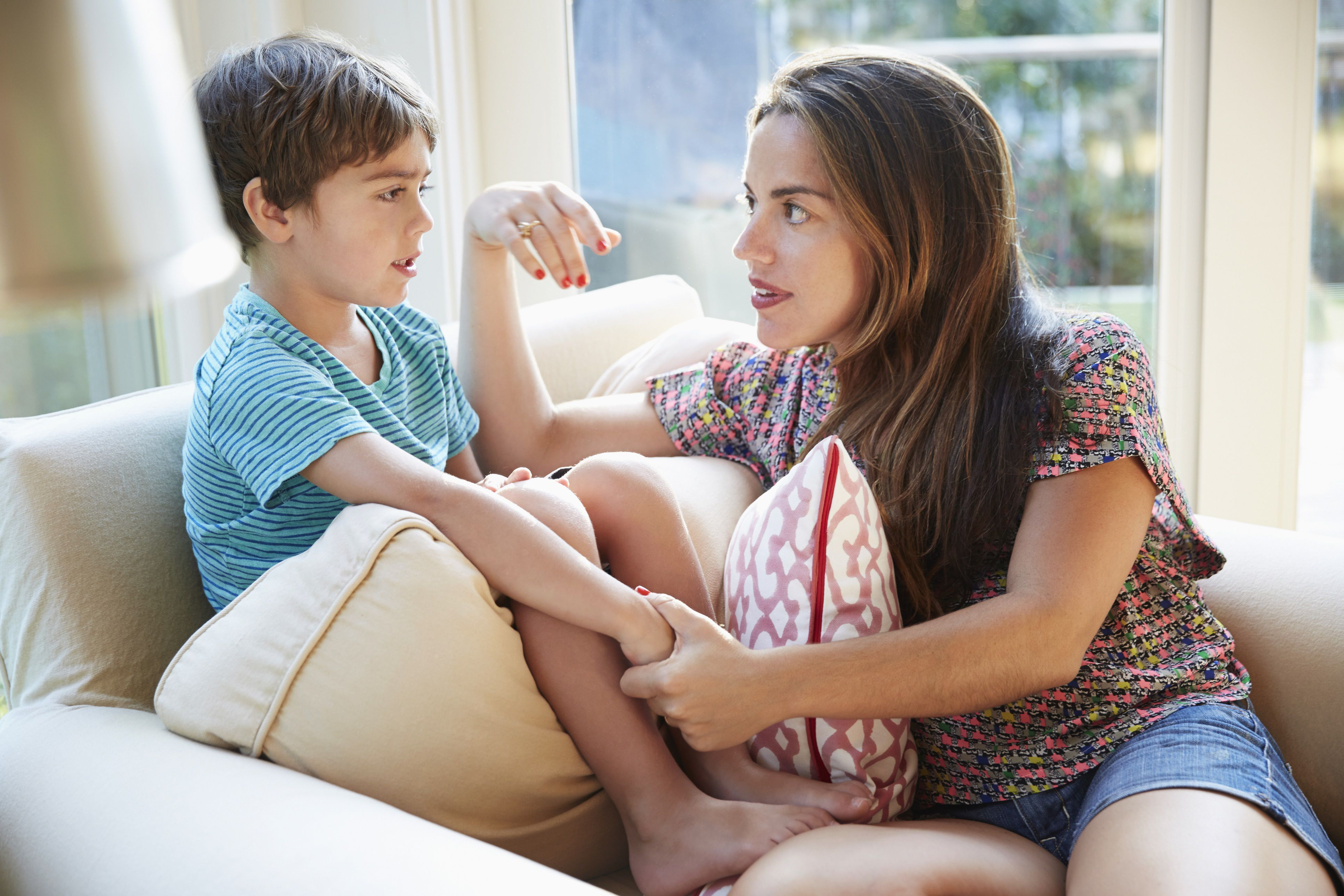 child discipline mother son talking