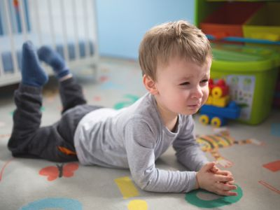 A toddler in time-out in his bedroom