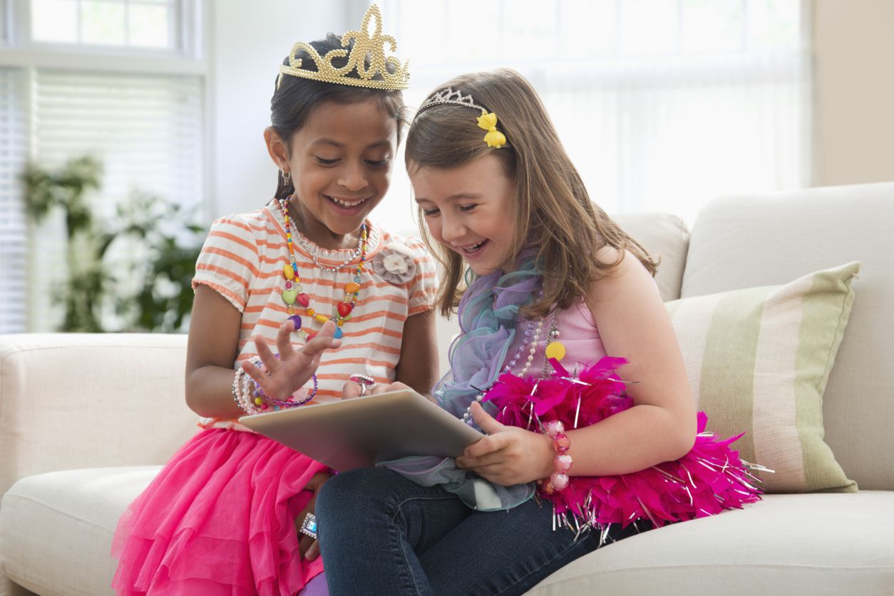 two girls playing with a tablet