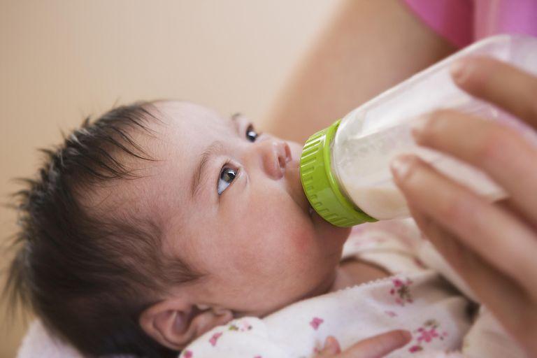 Mother bottle feeding