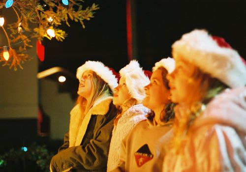 Make sure your tween is dressed for the weather when Christmas caroling.