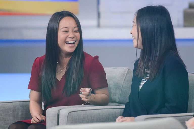 Separated at birth twin sisters Samantha Futerman (L) and Anais Bordier tape an interview at 'Good Morning America' at the ABC Times Square Studios on October 29, 2014 in New York City.