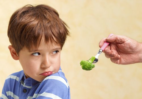 Boy Refusing to Eat His Vegetables