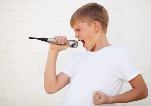 Boy singing with conviction