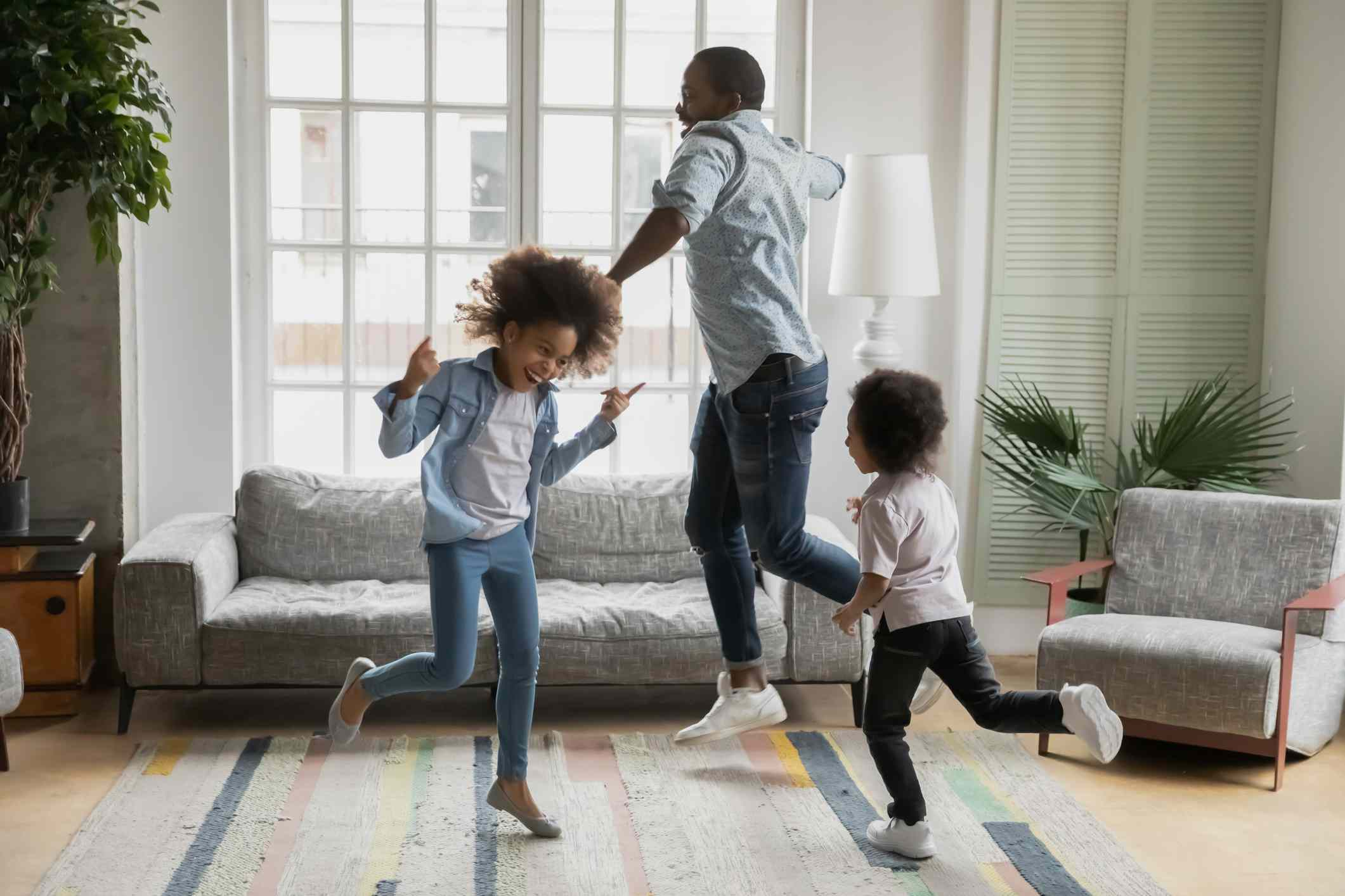Father, son, and daughter dancing to music