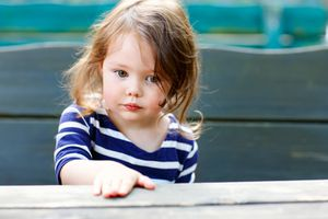 Brunette girl in striped shirt