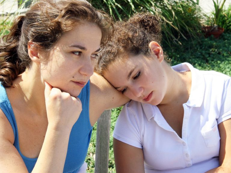 Mother and daughter looking sad