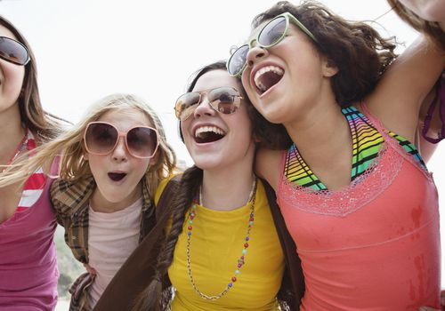 A group of teenage girls laughing