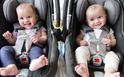Twin babies in carseats
