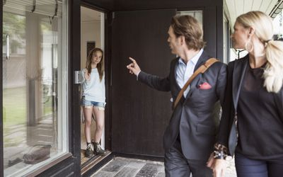 Parents talking to teen as they leave the house