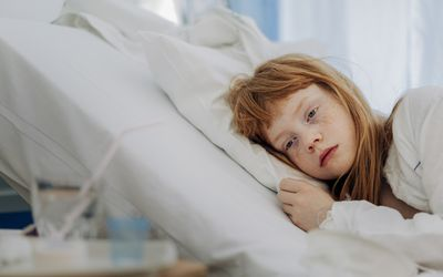 Child sick in hospital bed
