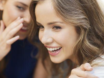two teens gossiping