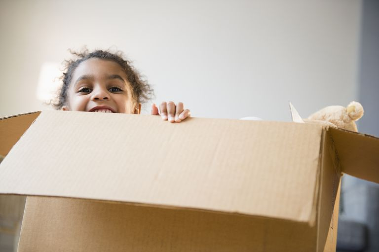 Young girl in a moving box.