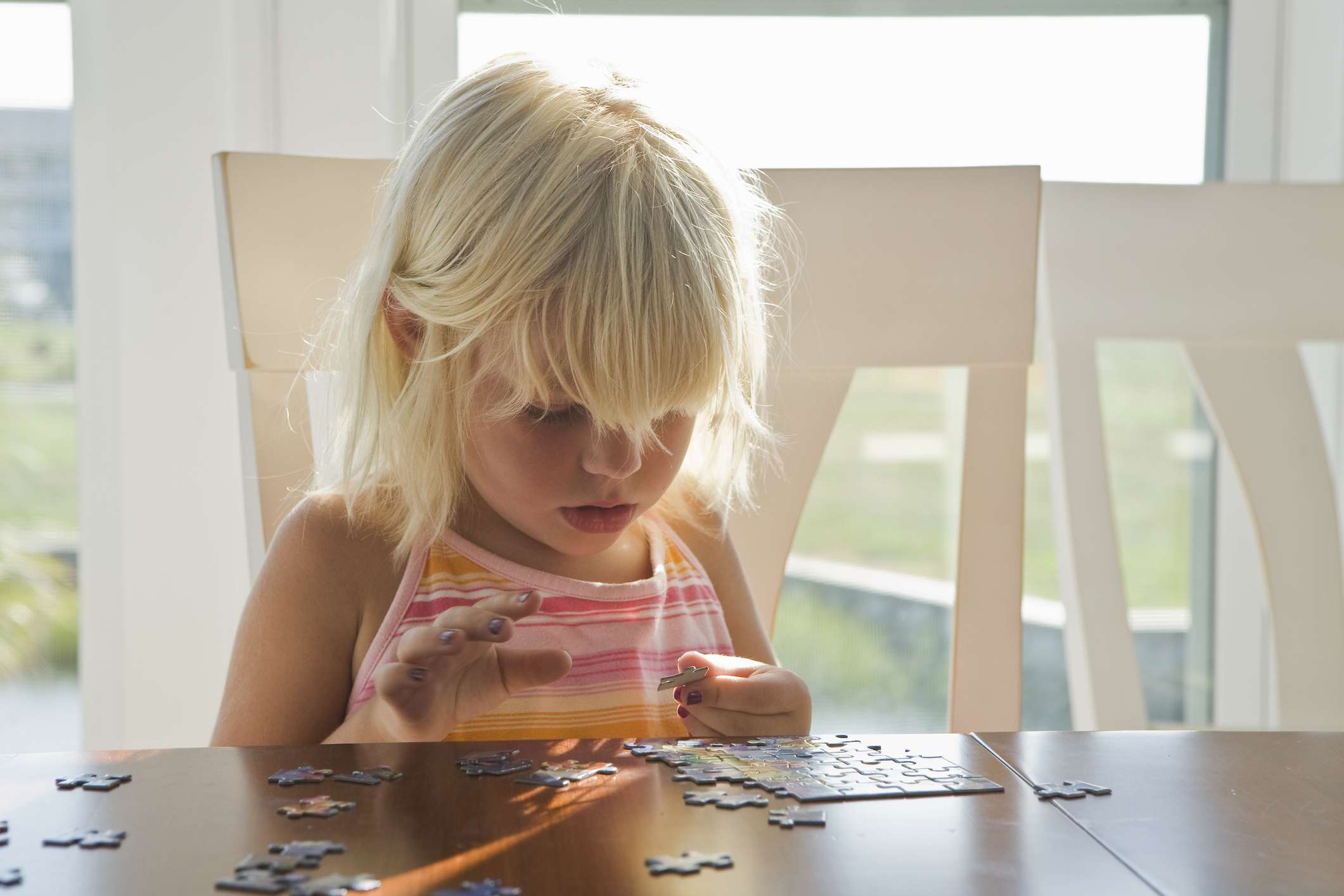 Little girl working on a puzzle