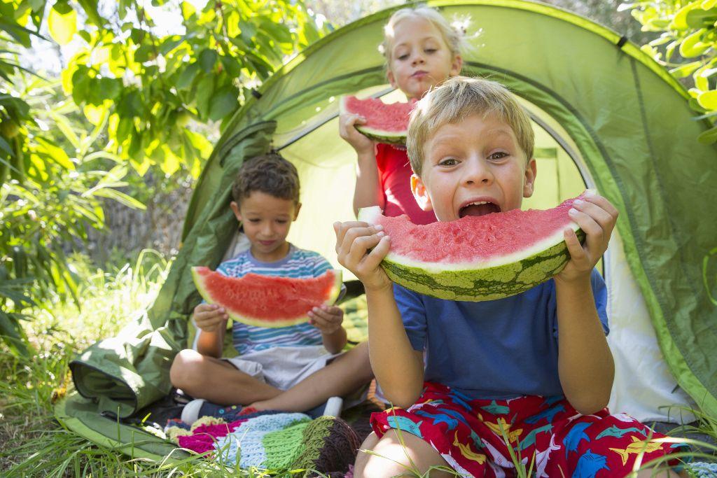 grandchildren enjoy backyard camping and watermelon at grandma camp