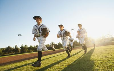 Baseball players running on diamond