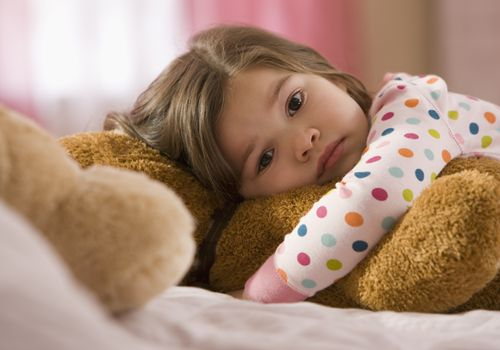 Girl awake in bed, kids' sleep problems