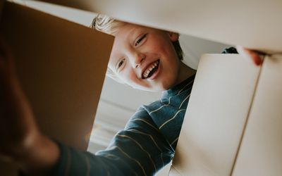 smiling boy opening a present