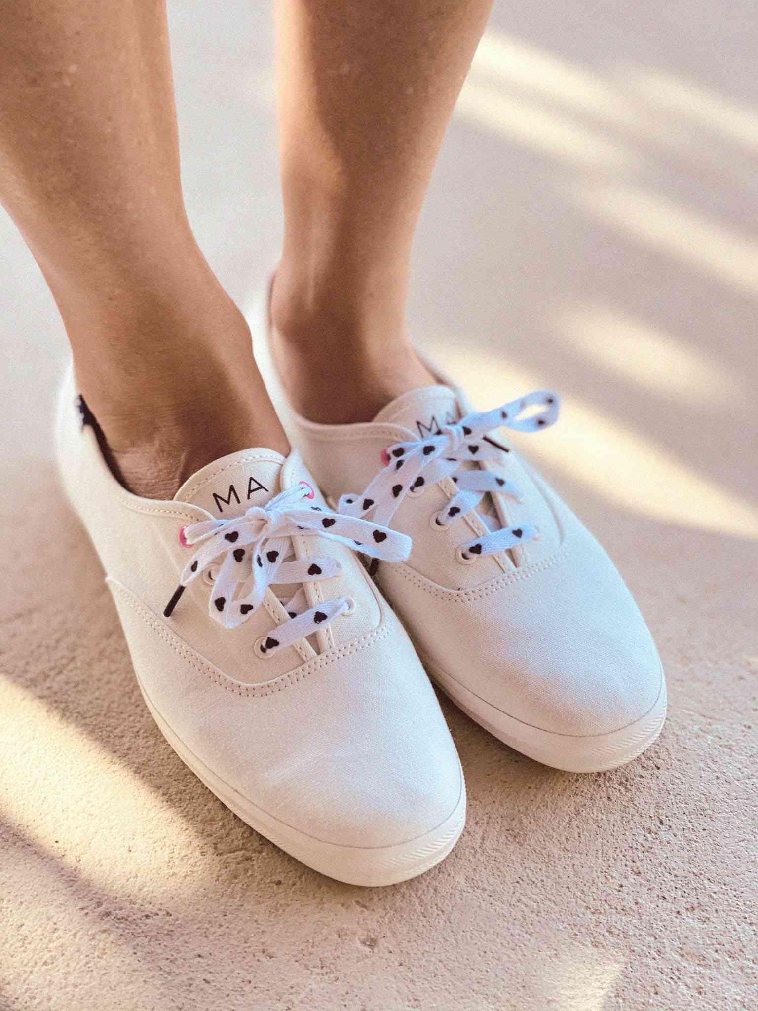 woman wearing Keds x HATCH sneakers