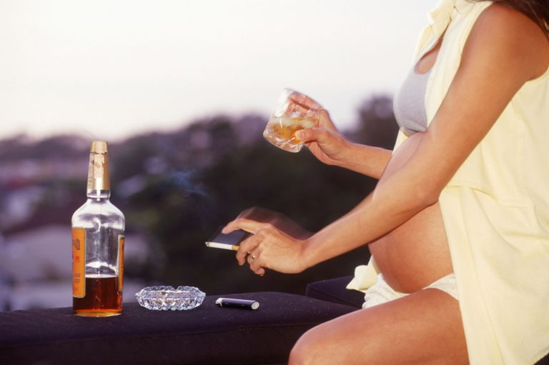 Pregnant woman smoking tobacco, drinking alcohol