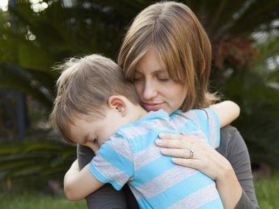 Mother hugging her son.