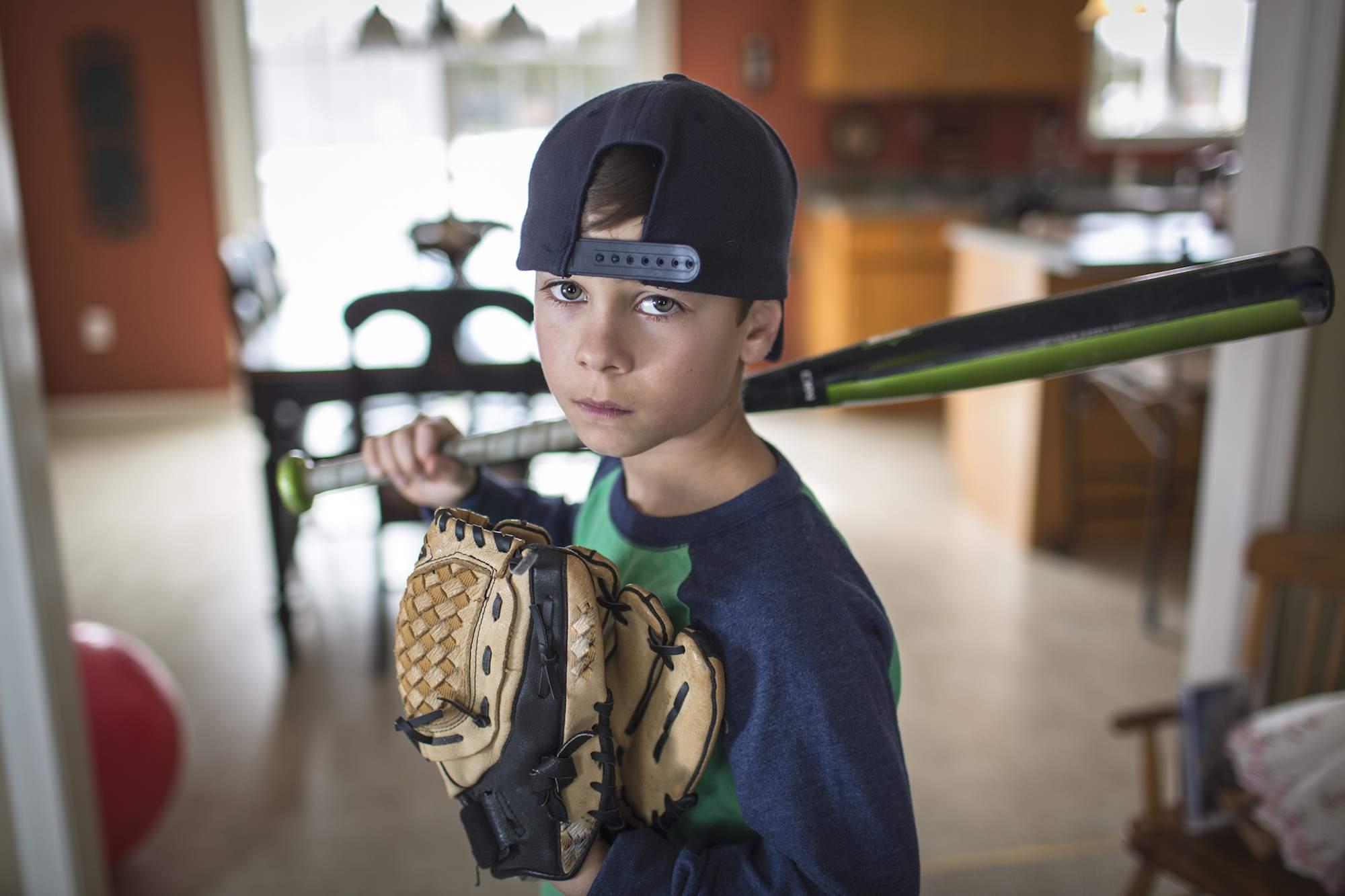Portrait of boy baseball player with attitude