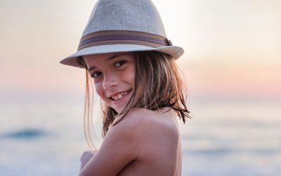 Little girl with a hat smiling